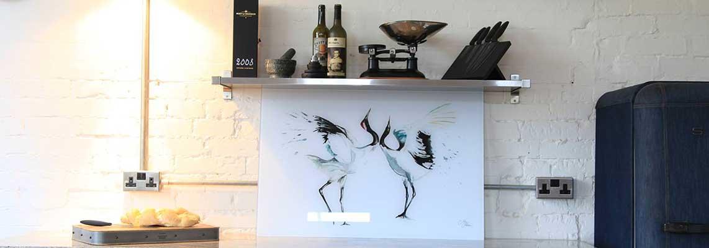 Two birds printed on a glass splashback